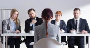 Woman being interviewed by panel © Photographee.eu/Shutterstock.com