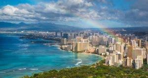 Rainbow over beach skyline in Hawaii | Mike Liu/Shutterstock.com
