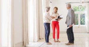 Couple speaking with realtor | Caiaimage/Martin Barraud/OJO+/Getty Images