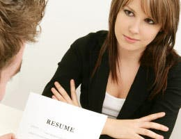 Woman's resume being reviewed