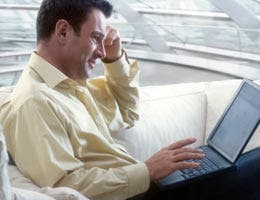 Middle-aged man using a laptop computer