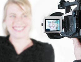 Woman smiling to a video camera