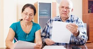 Couple working on finances together © Iakov Filimonov/Shutterstock.com