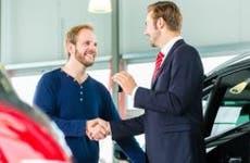 Man buying car from showroom © Kzenon/Shutterstock.com