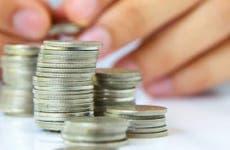 Multiple stacks of quarters © ponsulak/Shutterstock.com