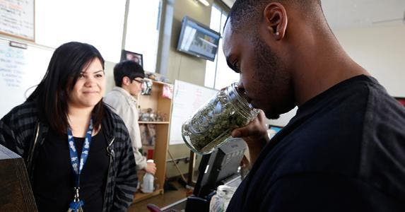 Man smelling jar full of cannabis © LUCY NICHOLSON/Reuters/Corbis