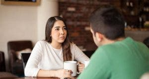 Young people sitting at coffee shop, talking © antoniodiaz/Shutterstock.com