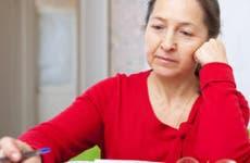 Woman thinking about paperwork © Iakov Filimonov/Shutterstock.com