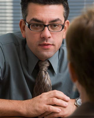 Employer interviewing job candidate © Bill Varie/Corbis