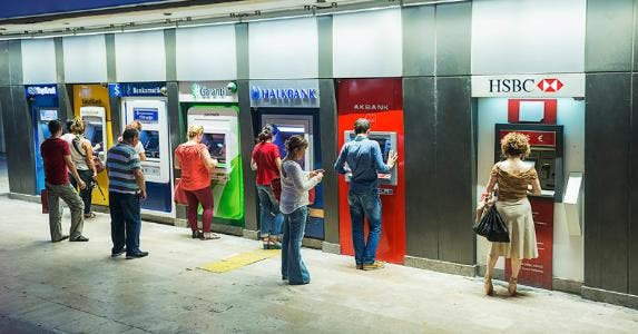 People using different bank ATMs © iStock