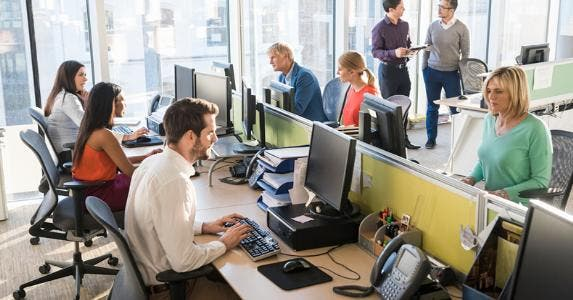 Employees working in open office © iStock