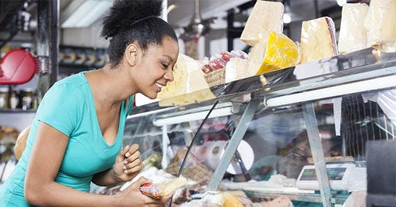 Woman shopping at deli counter