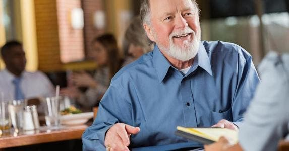 Smiling mature man in job interview meeting | iStock.com/Steve Debenport