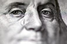 Close up shot of Benjamin Franklin tearing up | burakpekakcan/E+/Getty Images