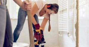 Young woman drilling tile floors during bath renovation   Guido Mieth/DigitalVision/Getty Images