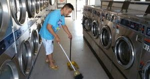 Frank Ahn sweeping laundromat | Photo courtesy of Frank Ahn