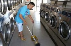 Frank Ahn sweeping laundromat | Photo courtesy of Frank Ahn