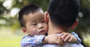 Toddler held by his dad © Denys Bogdanov/Shutterstock.com