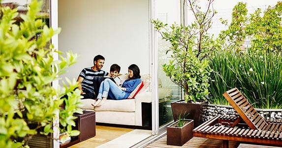 Buy a house | Thomas Barwick/Getty Images