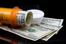 Prescription pill bottle and money
