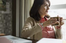 Older woman holding coffee mug   Hero Images/Getty Images