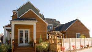Modern wood-paneled house on sunny day | Sarah-Jane Joel/Getty Images