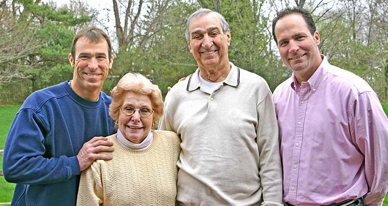 Senior parents with two adult sons © sonya etchison/Shutterstock.com