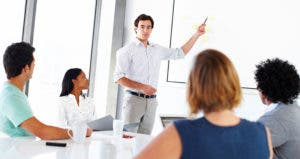 Man presenting to coworkers