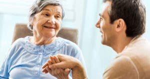 Senior mother speaking with son © iStock