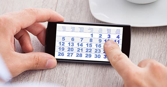 Person looking at calendar on phone