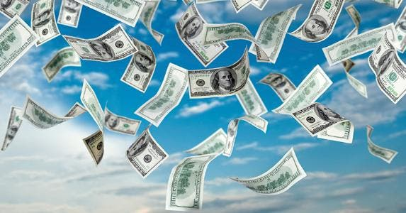 $100 bills falling from the blue sky © iStock