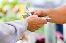 Male customer handing cash to store employee