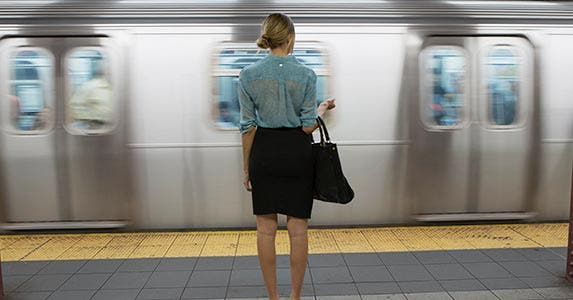 Young woman waiting on the subway
