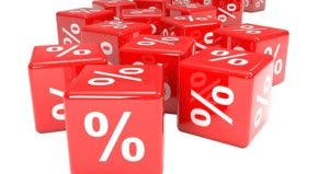 Percentage sign on red dice © iStock