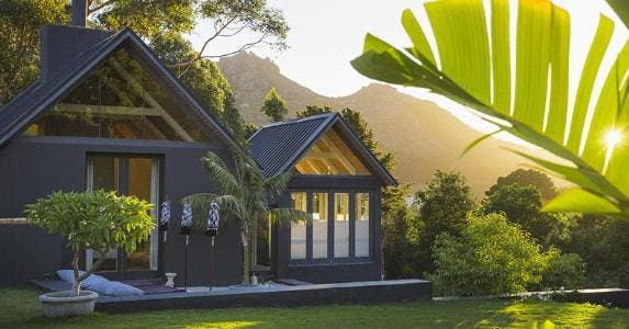 Modern house on hill in tropical location | Portra Images/DigitalVision/Getty Images