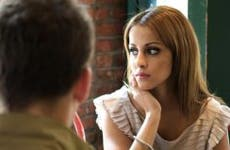 Uninterested woman on a date | Li Kim Goh/E+/Getty Images