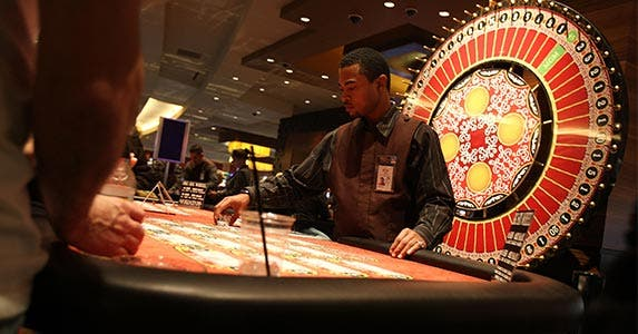 Casino dealer | SpencerPlatt/Getty Images