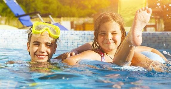 Kids swimming in inground pool © Dasha Petrenko/Shutterstock.com