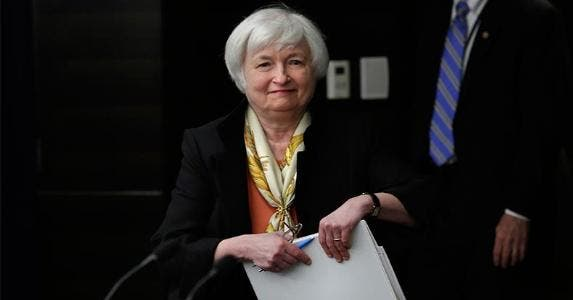 Smiling Janet Yellen holding folder | Yuri Gripas/Getty Images