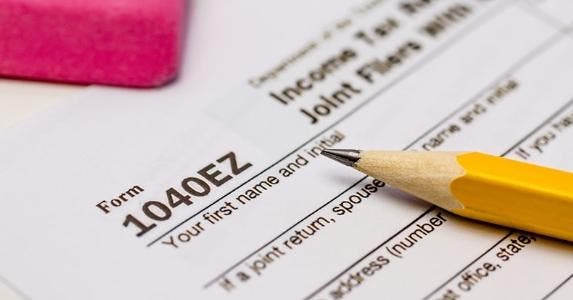 Form 1040EZ with pencil and pink eraser © Teri Virbickis/Shutterstock.com