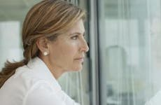 Serious woman looking out of window   PhotoAlto/Antoine Arraou/Getty Images