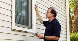 Home inspector checking windows | iStock.com