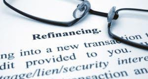 Refinancing definition with glasses © alexskopje/Shutterstock.com