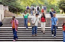 Students walking in campus outdoors | Blend Images – Andersen Ross/BrandX Pictures/Getty Images