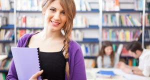 Young female college student in library © Minerva Studio/Shutterstock.com