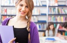 Young female college student in library © Minerva Studio/Shutterstock.com