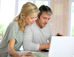 Questions to ask before refinancing a vacation home © Goodluz/Shutterstock.com