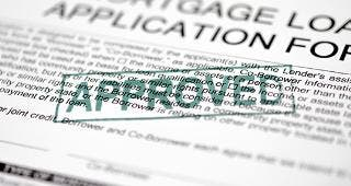 Approved mortgage loan application form © turhanyalcin / Fotolia.com