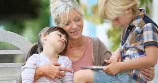 Grandmother holding children © Goodluz/Shutterstock.com