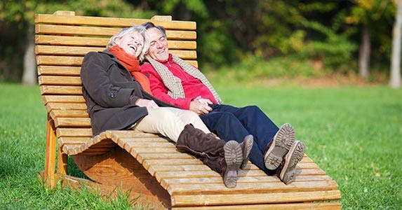 Older couple sitting on a big lounge chair